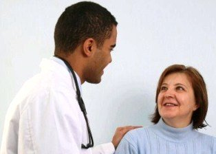 woman and doctor discussing health concerns