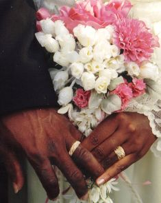 man and women holding hands showing wedding rings